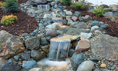 How to build a pondless waterfall pondless water feature for Build a simple backyard waterfall